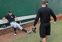 Pitcher Jeffrey Soptic (23) of the Bristol White Sox, Appalachian League affiliate of the Chicago White Sox, talks in the bullpen with trainer Kevin Pillifant prior to a game against the Elizabethton Twins on August 18, 2011, at Joe O'Brien Field in Elizabethton, Tennessee. Soptic was Chicago's third-round pick in the 2011 First-Year Player Draft. (Tom Priddy/Four Seam Images)