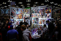 People walk near of a stand while they attend the annual event Comic Con in New York.  09.05.2014. Eduardo Munoz Alvarez/VIEWpress