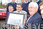 Principal Ed O'Neill presents Minister Batt O'Keeffe a picture of the 1962/63 football team which he captained to win the Munster cup during his visit to the college on Friday