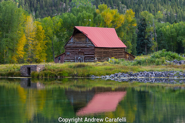 An Old Barn stands on a small lake outside of Lake City, Colorado.
