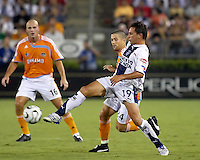 CF Pachuca midfielder Christian Gimenez (19) passes away from Houston Dynamo defender Wade Barrett (24). CF Pachuca defeated Houston Dynamo 4-3 in penalty kicks after a 2-2 tie in regulation and extra time at Robertson Stadium in Houston, TX on August 14, 2007 in the SuperLiga semi-finals.