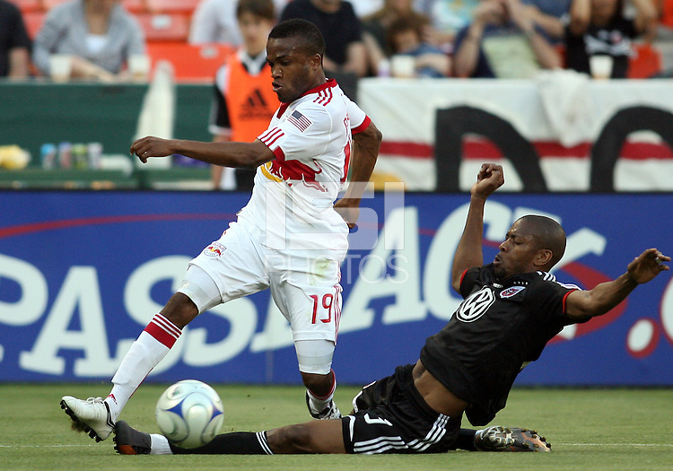 Avery John #3 of D.C. United slides the ball away frpom Dane Richards #19 of New York Red Bulls during a U.S. Open Cup match at RFK Stadium on May 20 2009, in Washington D.C. D.C. United won 5-3.
