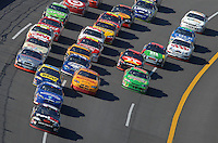 Apr 29, 2007; Talladega, AL, USA; Nascar Nextel Cup Series driver Denny Hamlin (11) leads the field during the Aarons 499 at Talladega Superspeedway. Mandatory Credit: Mark J. Rebilas