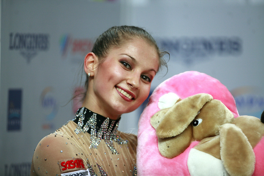 """September 21, 2007; Patras, Greece;  Simona Peycheva of Bulgaria smiles with doll at """"kiss & cry"""" during All-Around final at 2007 World Championships Patras.  Simona placed 10th in the AA to  help Bulgaria to receive the 1st of 2 positions for the individual All-Around competition at Beijing 2008 Olympics.  Photo by Tom Theobald. ."""