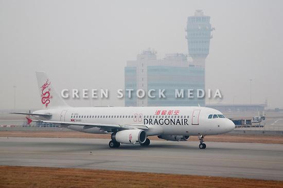 A DragonAir Airbus A320 airplane at runway.  DragonAir is Hong Kong's domestic airline. Hong Kong, People's Republic of China