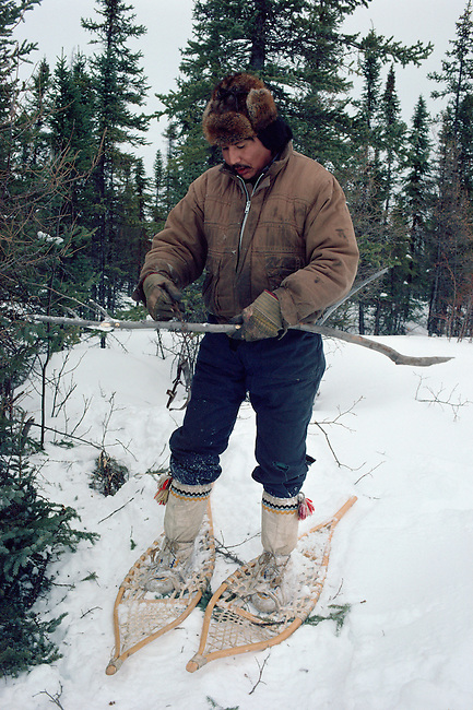 Moise Punch, a Slavey (Dene) Indian hunter from Trout Lake out checking his trapline in the forest near Island River. NWT, Canada.
