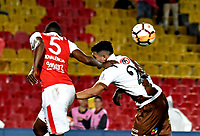 BOGOTA - COLOMBIA - 20 - 02 - 2018: Juan Valencia (Izq.) jugador de Independiente Santa Fe disputa el balón con Luis Garcia (Cent) jugador de Santiago Wanderers, durante partido de vuelta entre Independiente Santa Fe (COL) y Santiago Wanderers (CHL), de la fase 3 llave 1, por la Copa Conmebol Libertadores 2018, jugado en el estadio Nemesio Camcho El Campin de la ciudad de Bogota. / Juan Valencia (L) player of Independiente Santa Fe vies for the ball with Luis Garcia (C) player of Santiago Wanderers, during a match for the second leg between Independiente Santa Fe (COL) and Santiago Wanderers (CHL), of the 3rd phase key 1, for the Copa Conmebol Libertadores 2018 at the Nemesio Camacho El Campin Stadium in Bogota city. Photo: VizzorImage  / Luis Ramirez / Staff.