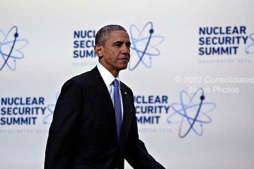 United States President Barack Obama arrives to speak during a news conference at the Nuclear Security Summit in Washington, D.C., U.S., on Friday, April 1, 2016. After a spate of terrorist attacks from Europe to Africa, Obama is rallying international support during the summit for an effort to keep Islamic State and similar groups from obtaining nuclear material and other weapons of mass destruction. <br /> Credit: Andrew Harrer / Pool via CNP