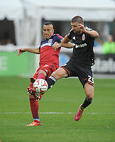 Washington D.C. - March 29, 2014: Alex of the Chicago Fire goes against Perry Kitchen (23) of D.C. United.  The Chicago Fire tied D.C. United 2-2 during a Major League Soccer match for the 2014 season at RFK Stadium.