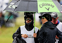 A caddie shelters from the rain. McKayson NZ Women's Golf Open, Round Four, Windross Farm Golf Course, Manukau, Auckland, New Zealand, Sunday 1st October 2017.  Photo: Simon Watts/www.bwmedia.co.nz