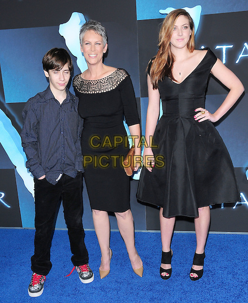 JAMIE LEE CURTIS & children.The Twentieth Century Fox World Premiere of Avatar held at The Grauman's Chinese Theatre in Hollywood, California, USA. .December 16th, 2009.full length son daughter kids family dress black crochet cut out neckline blue shirt jeans denim hand on hip.CAP/RKE/DVS.©DVS/RockinExposures/Capital Pictures.