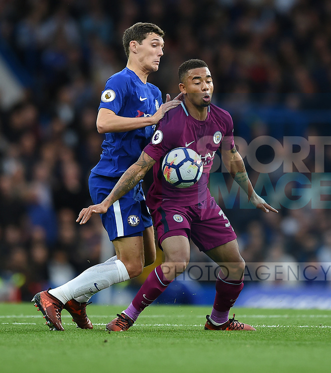 Gabriel Jesus of Manchester City is challenged by Antonio Rudiger of Chelsea during the premier league match at the Stamford Bridge stadium, London. Picture date 30th September 2017. Picture credit should read: Robin Parker/Sportimage