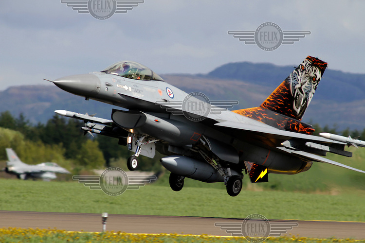 A Norwegian F-16 with a tiger paint scheme takes off. Nato Tiger Meet is an annual gathering of squadrons using the tiger as their mascot. While originally mostly a social event it is now a full military exercise. Tiger Meet 2012 was held at the Norwegian air base Ørlandet.