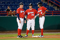 Brevard County Manatees manager Joe Ayrault #67 talks with Greg Hopkins #14 and Yadiel Rivera #3 during a game against the Daytona Cubs at Spacecoast Stadium on April 5, 2013 in Viera, Florida.  Daytona defeated Brevard County 8-0.  (Mike Janes/Four Seam Images)