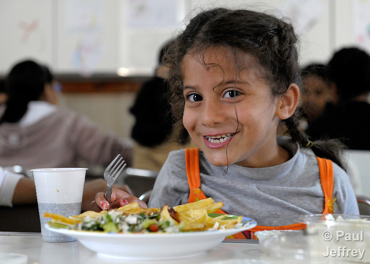 Seven-year old Asawer Kusai eats lunch in a shelter near Beirut for Iraqi refugees and other residents of Lebanon who have suffered from domestic violence and other forms of violent abuse. The shelter, a program of the Caritas Lebanon Migrant Center, which is funded by Catholic Relief Services, the relief and development agency of the U.S. Catholic community, is located in an unnamed community on the outskirts of Beirut.