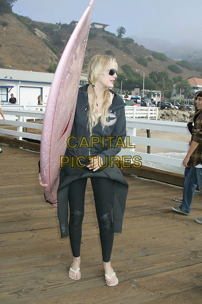 DARYL HANNAH.A Day at the Beach and Paddle Out Protest against the proposed Liquid Natural Gas Facility Construction held at Malibu Surfrider Beach, Malibu, California, USA,.22 October 2006..full length pink surf board sunglaases black wetsuit wet suit.Ref: ADM/RE.www.capitalpictures.com.sales@capitalpictures.com.©Russ Elliot/AdMedia/Capital Pictures.