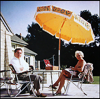 BNPS.co.uk (01202 558833)<br /> Pic: HattieMiles/BNPS<br /> <br /> Mantovani with wife Winifred outside his home in Poole.<br /> <br /> A retired businessman has spent £26,000 laying on his very own a show in tribute to his hero - the musical maestro Annunzio Paolo Mantovani.<br /> <br /> Paul Barrett, 72, will perform in a 48-piece orchestra he has hired for the performance that he is prepared to make a loss of thousands of pounds on.<br /> <br /> Mr Barrett said he plans to do 'everything bar conducting' in the musical extravaganza being hosted at the Bournemouth Pavilion Theatre in Dorset.