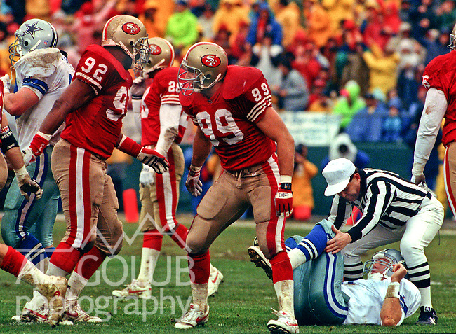 San Francisco 49ers vs. Dallas Cowboys at Candlestick Park Sunday, January 17,1993.  Cowboys beat 49ers 30-20.  San Francisco 49ers linebacker Tim Harris (92) and linebacker Mike Walter (99) celebrate sacking Dallas Cowboys quarterback Troy Aikman (8).