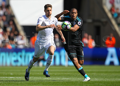 May 21st 2017, Liberty Stadium, Swansea Wales;  EPL Premier league football, Swansea versus West Bromwich Albion; Federico Fernandez of Swansea City (L) and Salomon Rondon (R) of West Bromwich Albion battle for possession during the match