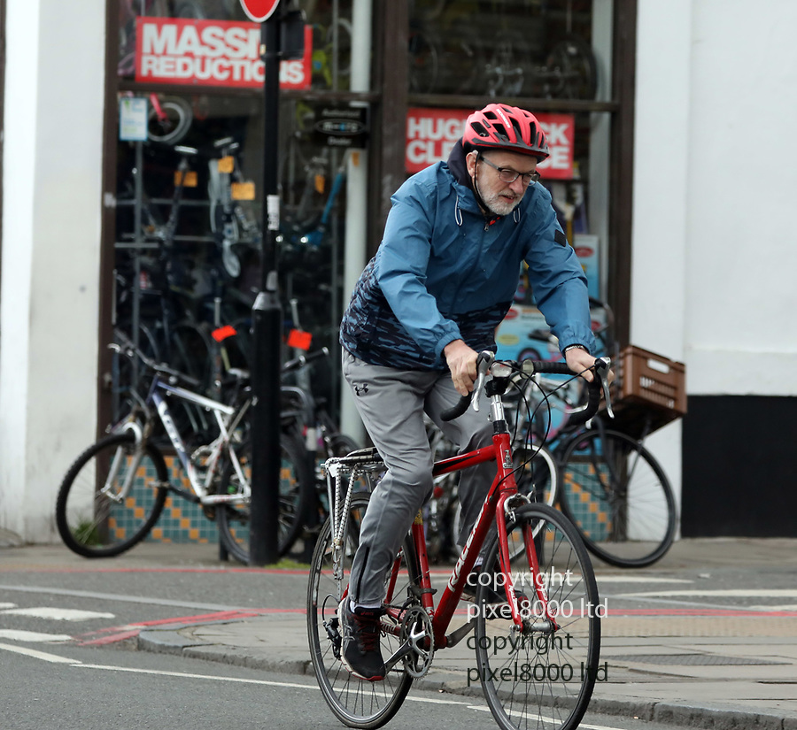 picture shows: Seat of power or on yer bike? Will Corbyn seize power in the event of an election as some polls predict? Or will he be saddled with anti-semitism charges forever?<br /> <br /> Jeremy Corbyn and wife Laura Alvarez  leaving home in London today on their way for a cycle ride.<br /> <br /> 14.4.19<br /> <br /> picture by Gavin Rodgers/ Pixel8000