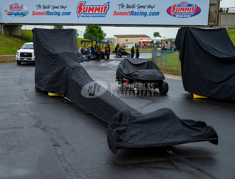 May 20, 2018; Topeka, KS, USA; The car of NHRA top fuel driver Antron Brown has a rain cover on it during a delay to the Heartland Nationals at Heartland Motorsports Park. Mandatory Credit: Mark J. Rebilas-USA TODAY Sports