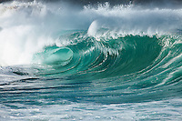 A large wave breaking at Waimea Shorebreak in Waimea Bay on the North Shore of O'ahu