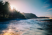 Waves wash over the rocks and sand of Pololu Beach on the North Kohala coastline of the Big Island.