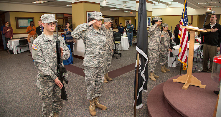 Army ROTC cadets Cesar Zavala, left, and Neha Sharma stand at attention during the Pledge of Allegiance as DePaul University hosted a Veterans Day Interfaith Service and Luncheon Wednesday, Nov. 11, 2015, to honor all military veterans. The gathering took place in the DePaul Center on the Loop campus. (DePaul University/Jamie Moncrief)