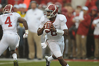 NWA Media/ J.T. Wampler - Alabama quarterback Blake Sims rolls out to look for a receiver during the first quarter  Saturday Oct. 11, 2014 against the Razorbacks.