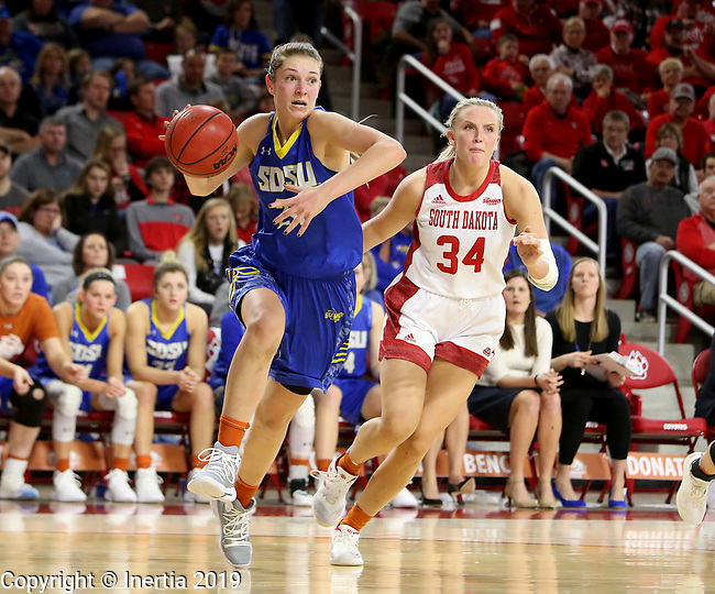 VERMILLION, SD - JANUARY 6: Tagyn Larson #24 from South Dakota State University drives to the basket past Hannah Sjerven #34 from the University of South Dakota during their game Sunday afternoon at the Sanford Coyote Center in Vermillion, SD. (Photo by Dave Eggen/Inertia)