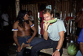 Capoto Village, Brazil. Sting eating watermelon with Chief Raoni of the Megranoti-Kayapo, Nov 1990.