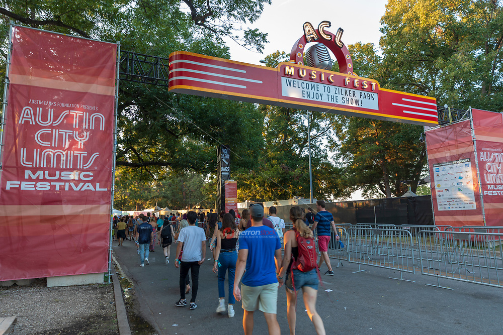 A steady stream of attendees arrive at the Barton Springs entrance of the ACL Music Festival entrance as festival concert goers arrive for this annual popular outdoor music festival held every October in Zilker Park in downtown Austin, Texas.
