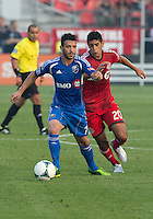 03 July 2013: Toronto FC midfielder Matias Laba #20 and Montreal Impact midfielder Felipe Martins #7 in action during an MLS game between the Montreal Impact and Toronto FC at BMO Field in Toronto, Ontario Canada.