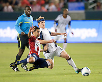 Chivas midfielder Paulo Nagamura (26) and Revolution midfielder Pat Phelan (28) during the first half of the game between Chivas USA and the New England Revolution at the Home Depot Center in Carson, CA, on September 10, 2010. Chivas USA 2, New England Revolution 0.