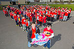 Glow Hearts for Crumlin -  Dillon Brosnan  Ciarán Doyle, students and staff from Holy family School supporting the wear Red in aid of Crumlin on Thursday
