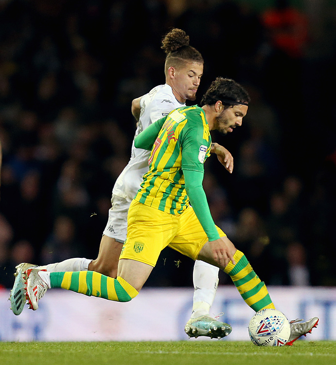 West Bromwich Albion's Filip Krovinovic under pressure from Leeds United's Kalvin Phillips<br /> <br /> Photographer Rich Linley/CameraSport<br /> <br /> The EFL Sky Bet Championship - Tuesday 1st October 2019  - Leeds United v West Bromwich Albion - Elland Road - Leeds<br /> <br /> World Copyright © 2019 CameraSport. All rights reserved. 43 Linden Ave. Countesthorpe. Leicester. England. LE8 5PG - Tel: +44 (0) 116 277 4147 - admin@camerasport.com - www.camerasport.com
