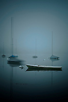Sailboats on fog shrouded Lake Harriet at dawn.