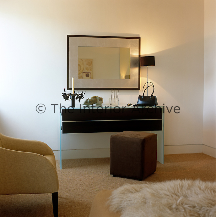 Clean lines and contemporary furniture continue the sophisticated theme with which the loft has been designed