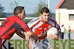 Tom McGoldrick Brosna goes past Damian dennehy Fossa during their Div 5 clash in Brosna on Sunday
