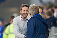 Leeds United manager Thomas Christiansen greets Cardiff City manager Neil Warnock during the Sky Bet Championship match between Cardiff City and Leeds United at the Cardiff City Stadium, Cardiff, Wales on 26 September 2017. Photo by Mark  Hawkins / PRiME Media Images.