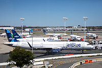 NEW YORK, NY - MAY 12: View of JetBlue planes at Terminal 5 of John F. Kennedy International Airport on May 12, 2020 in New York, NY. (Photo by Pablo Monsalve / VIEWpress via Getty Images)