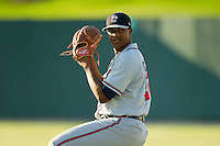 Rome Braves starting pitcher Mauricio Cabrera (22) warms up in the outfield prior to the game against the Kannapolis Intimidators at CMC-Northeast Stadium on August 24, 2013 in Kannapolis, North Carolina.  The Intimidators defeated the Braves 6-1.  (Brian Westerholt/Four Seam Images)