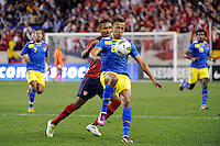 Eduardo Morante (2) of Ecuador plays the ball in front of Juan Agudelo (18) of the United States. The men's national team of the United States (USA) was defeated by Ecuador (ECU) 1-0 during an international friendly at Red Bull Arena in Harrison, NJ, on October 11, 2011.