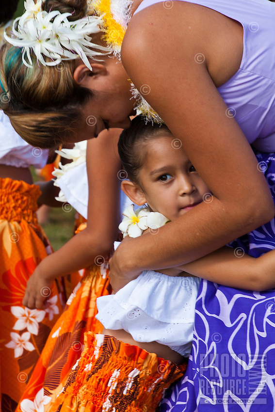 A woman embracing a young hula dancer at the 2011 Kauai Polynesian Festival