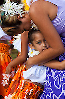 A woman embracing a young hula dancer at the 2011 Kauai Polynesian Festival