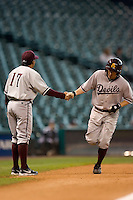 Arizona State's Eric Sogard (28) shakes hands with third base coach Andy Stankiewicz (17) following his first inning solo home run versus Houston at the 2007 Houston College Classic at Minute Maid Park in Houston, TX, Sunday, February 11, 2007.  The Sun Devils  defeated the Cougars 11-1.