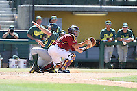 Garrett Stubbs (51) of the Southern California Trojans waits for the throw as Phil Craig-St.Louis (42) of the Oregon Ducks slides into home plate during a game at Dedeaux Field on April 18, 2015 in Los Angeles, California. Oregon defeated Southern California, 15-4. (Larry Goren/Four Seam Images)