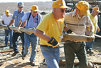Koh Lanta, Thailand--Oklahoma Baptist Disaster Relief volunteers move a heavy structural beam to the site of a new house in the village of Hua Laem on Koh Lanta island, Thailand.  They group, made up primarily of men between the ages of 65 and 80,  had been traveling through Southern Thailand for a few days looking for somewhere to help but had been turned down everywhere while communities waited for government intervention.  David Karam, of Brewster, MA, ran into them in Koh Lanta's biggest town, Sa La Dan and brought them over to Hua Laem where they helped with clean-up and construction of new homes.  01/27/05 © Julia Cumes / The Image Works