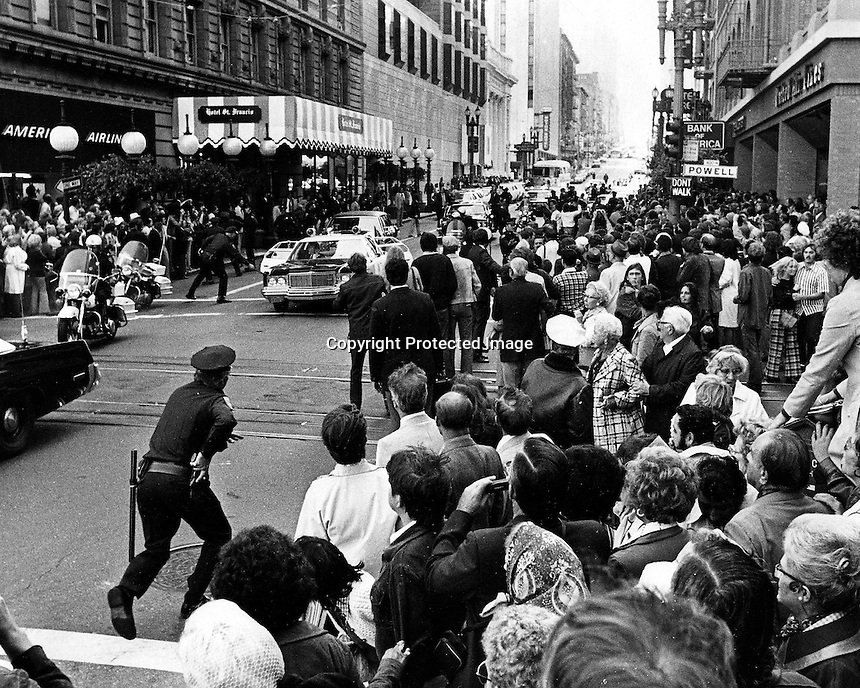 Assassination attempt on President Gerald Ford. Police react after Sara Jane Moore fired a shot at Ford as he exited the St. Francis Hotel. Ford was not hit..(photo copyright 1975 by Ron Riesterer)