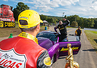 Sep 16, 2018; Mohnton, PA, USA; NHRA pro stock driver Vincent Nobile (right) celebrates with brother in law, pro stock motorcycle rider Hector Arana Jr after winning the Dodge Nationals at Maple Grove Raceway. Mandatory Credit: Mark J. Rebilas-USA TODAY Sports